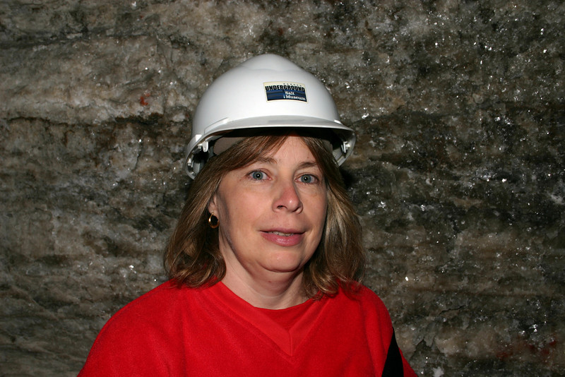 Anita modeling the stylish headgear they gave us wear down in the mine.