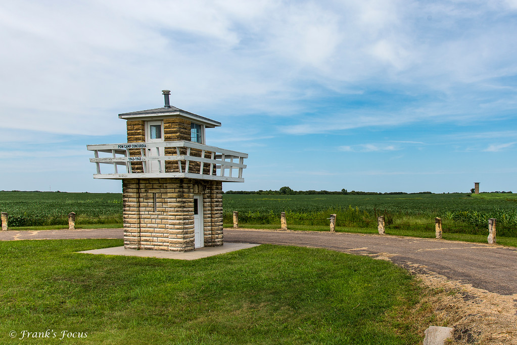 """This guard tower is one of only 3 surviving original buildings at POW Camp Concordia, just outside Concordia, Kansas.  Camp Concordia was a World War II internment camp for German POWS captured primarily in battles across North Africa from May 1, 1943 through November 8, 1945. At its height, the camp held over 4,000 German POWs. Strategically located in the heartland of America, where prisoners could be employed on local farms, the camp saw only 2 escapes and 8 POW deaths during its operation.<br /> <br /> Hastily built in the spring of 1943, construction of Camp Concordia began in February, 1943 and the POW camp was turned over to the US Army on May 1, 1943. During this 90-day construction period, the contractors erected 304 buildings including a 177 bed hospital, fire department, warehouses, cold storage, and officers club, and barracks, mess halls & administrative buildings for both the German POWs and American soldiers.  Total cost of building the Camp Concordia was $1,808,806.  At its peak Camp Concordia housed 4,027 Prisoners, 880 soldiers and 179 civilian Employees.<br /> <br /> If interested, more about Camp Concordia can be found here:  <a href=""""http://powcampconcordia.org/about.php"""">http://powcampconcordia.org/about.php</a>"""