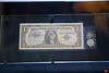 This is one of the dollar bills and coins that Gus Grissom took up in the Liberty Bell 7 (Mercury program). This was the second sub-orbital manned mission by the United States.<br /> _MG_7434