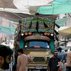 Passing a tall truck through a covered market, Karachi, Pakistan<br /> scenes of daily life in markets and bazaars in Karachi<br /> (Credit Image: © Chris Kralik/KEYSTONE Press)