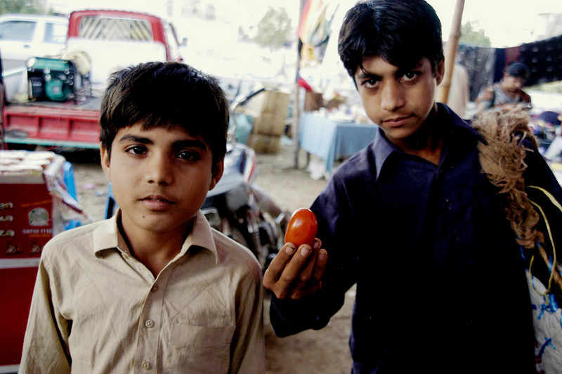 Hire the kids and they'll carry your purchases as you shop, Karachi, Pakistan<br /> scenes of daily life in markets and bazaars in Karachi<br /> (Credit Image: © Chris Kralik/KEYSTONE Press)