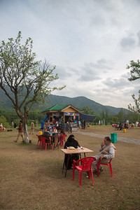 Visitors enjoy the snacks and drinks at the small food counter at Tulip Garden, Jammu and Kashmir, India. Asia's Largest, with 20 lakh tulips of 46 varieties spread over 30 hectares in the foothills of the snow-clad Zabarwan range.
