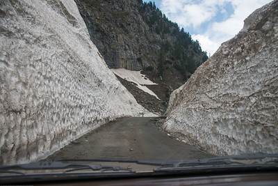 Heaps of snow on either side of the road cleared between Srinagar to Sonamarg on the Srinagar-Leh Highway, Kashmir, J&K, India.