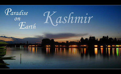 Kashmir - Paradise on Earth. This image is a shot of the Dal Lake with the lights on the boat houses floating on the water in the evening as seen from Nehru Road.