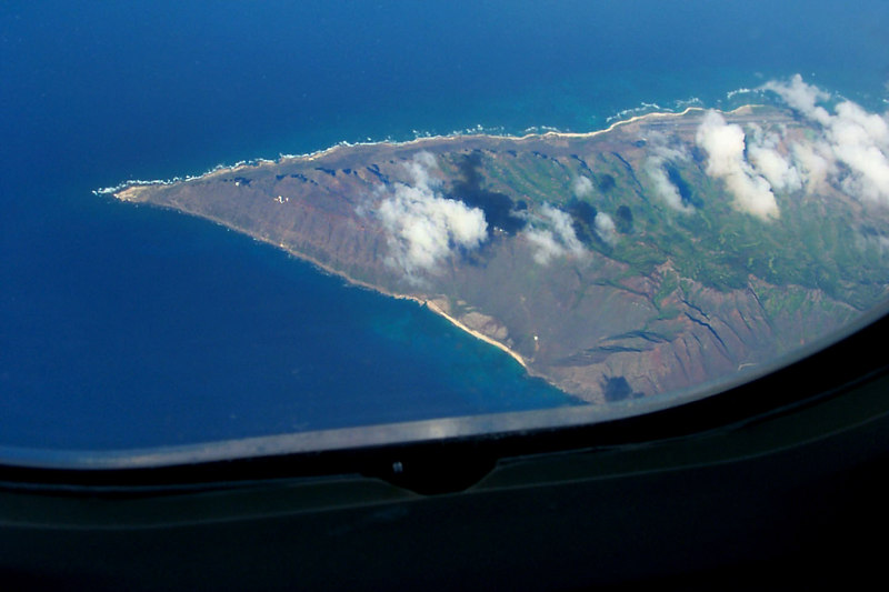 After flying over water for about six hours, we finally saw land. It was the west end of Oahu.