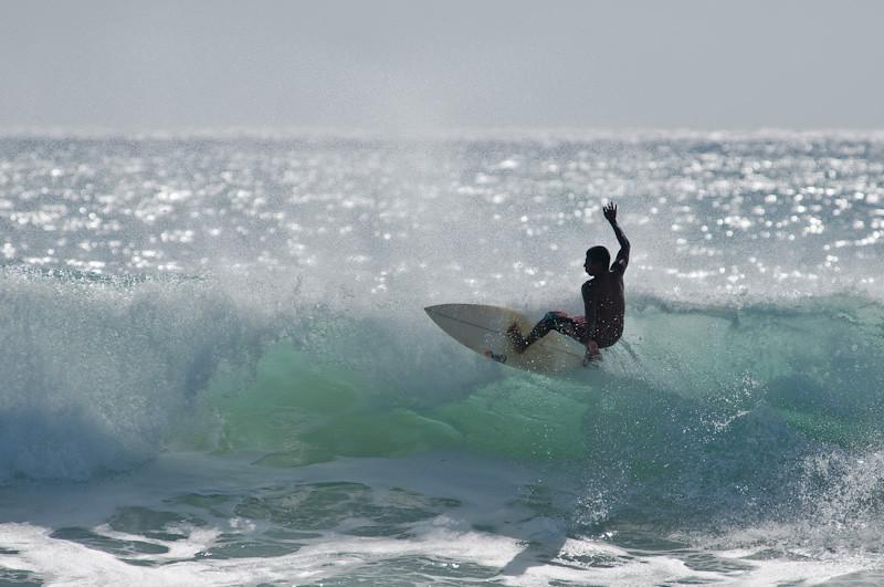 Surfer at Kekaha Beach