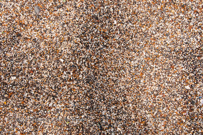 The sand at Glass Beach in 'Ele'ele in Kauai is colorful due to the presence of smooth broken glass.