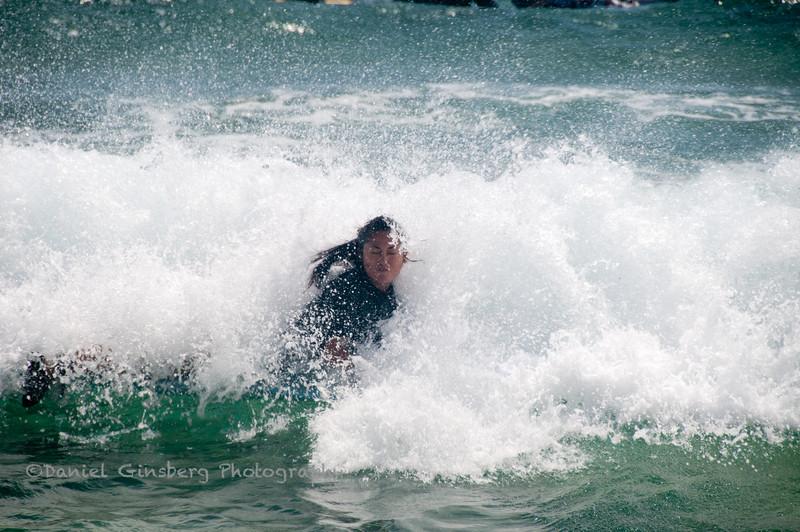 Caught in a breaking surf while learning to surf.