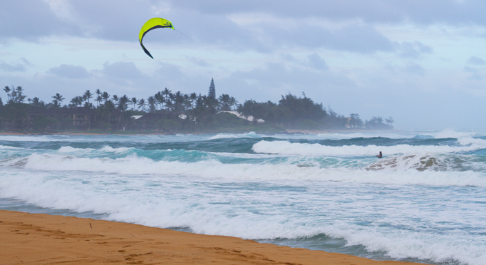 Back on the ground, we made another stop at the Twisted Turtles Yarn Shop.  On the route back to Princeville we passed this beach (Kapa'a Beach Park, I think) where the waves were huge.  This sail surfer was taking advantage of it.  Amazing!