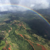 This rainbow was the most complete circle I've ever seen.  It was visible except for (maybe 45 degrees) under the plane. Exquisite! We saw several rainbows of varying lengths on this flight.