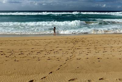 Virginia enjoys the surf at the Polihale Park Beach