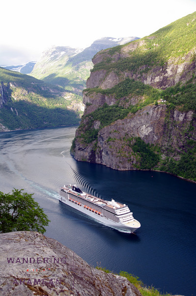 One of the many cruiseliners heading back out of the fjord
