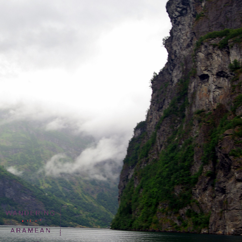 The man in the wall looking down at the fjord
