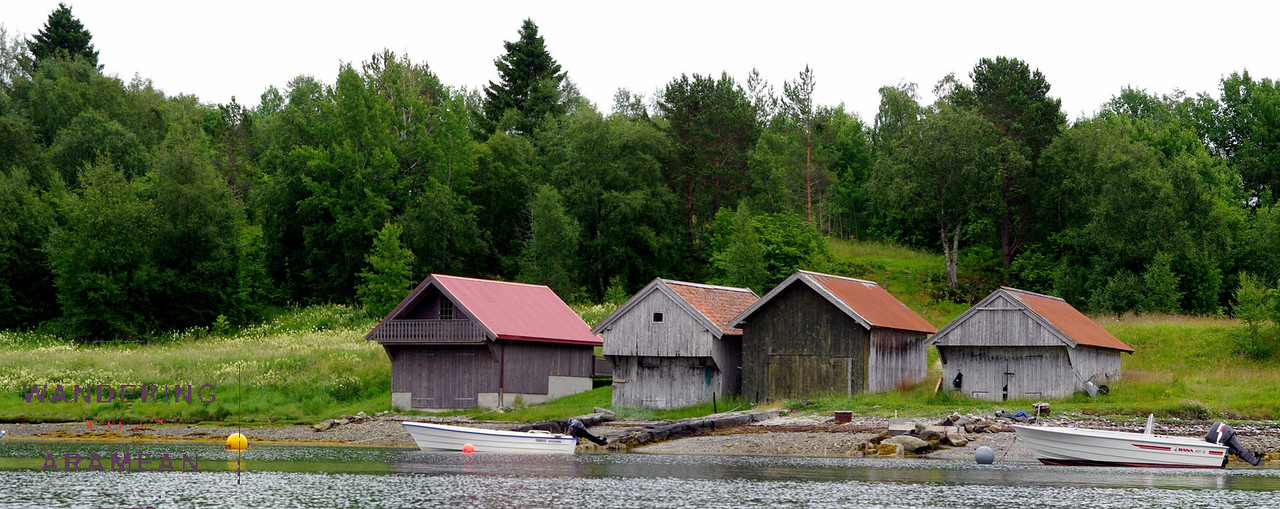Boathouses on the shore of the fjord