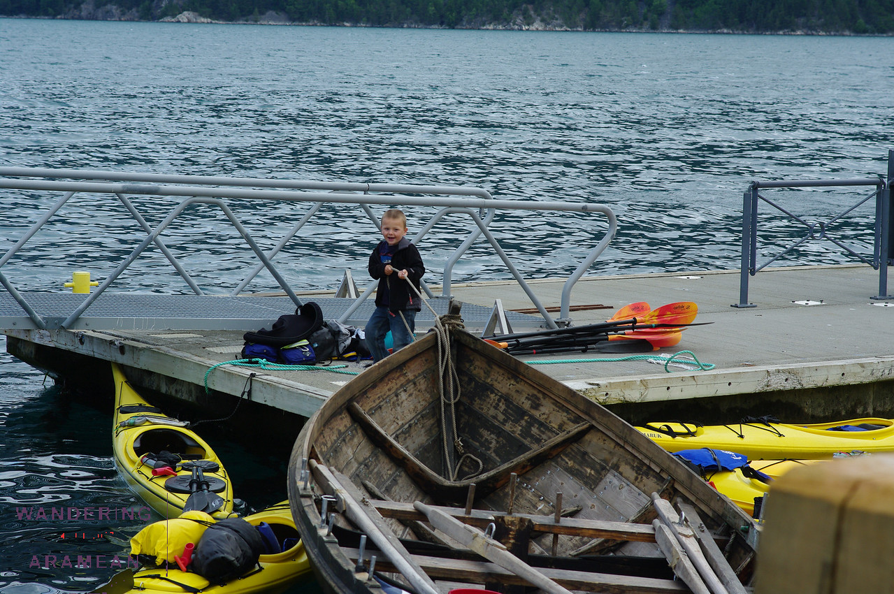 This kid was having a lot of fun playing with the boats on the dock