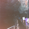 Entering Cave - Mammoth Caves Historic Tour - Mammoth Cave National Park, Kentucky - May 1995<br /> Mammoth Cave, by far the world's longest known cave system, is the heart of the South-Central Kentucky karst, an integrated set of subterranean drainage basins covering more than 1,050 square kilometers – 400 square miles. Atop this labyrinth is a biologically diverse set of ecosystems inextricably interlinked with the ecosystems underground. This physiographic province, with Mammoth Cave National Park at its core, was declared an International Biosphere Reserve in 1990.