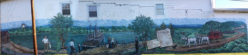 This is a mural painted on the entire side of a building in Burkesville, KY. It depicts the history of the area. Taken in October 2007.