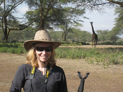 On a walking safari in the Green Crater National Park with a passing giraffe in the background.
