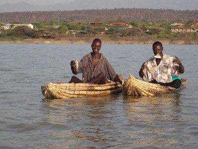 Local fisherman on Lake Baringo.  Their boats are made of balsa wood and will float for up to 6 hours, after that they have to be hung up to dry out or they'll sink.