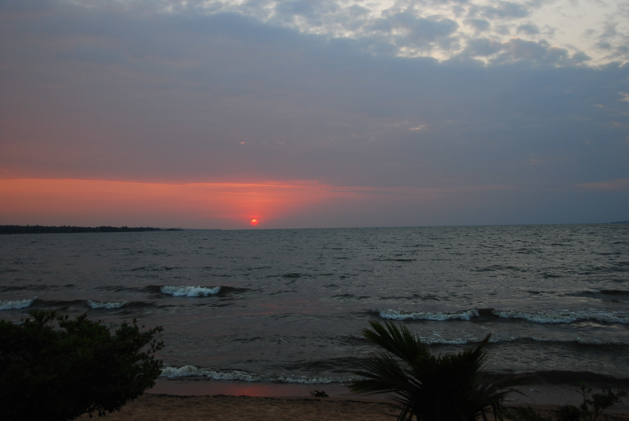 Sunset over Lake Victoria, Tanzania.  Lake Victoria is the largest lake in Africa and the second largest freshwater lake in the world.