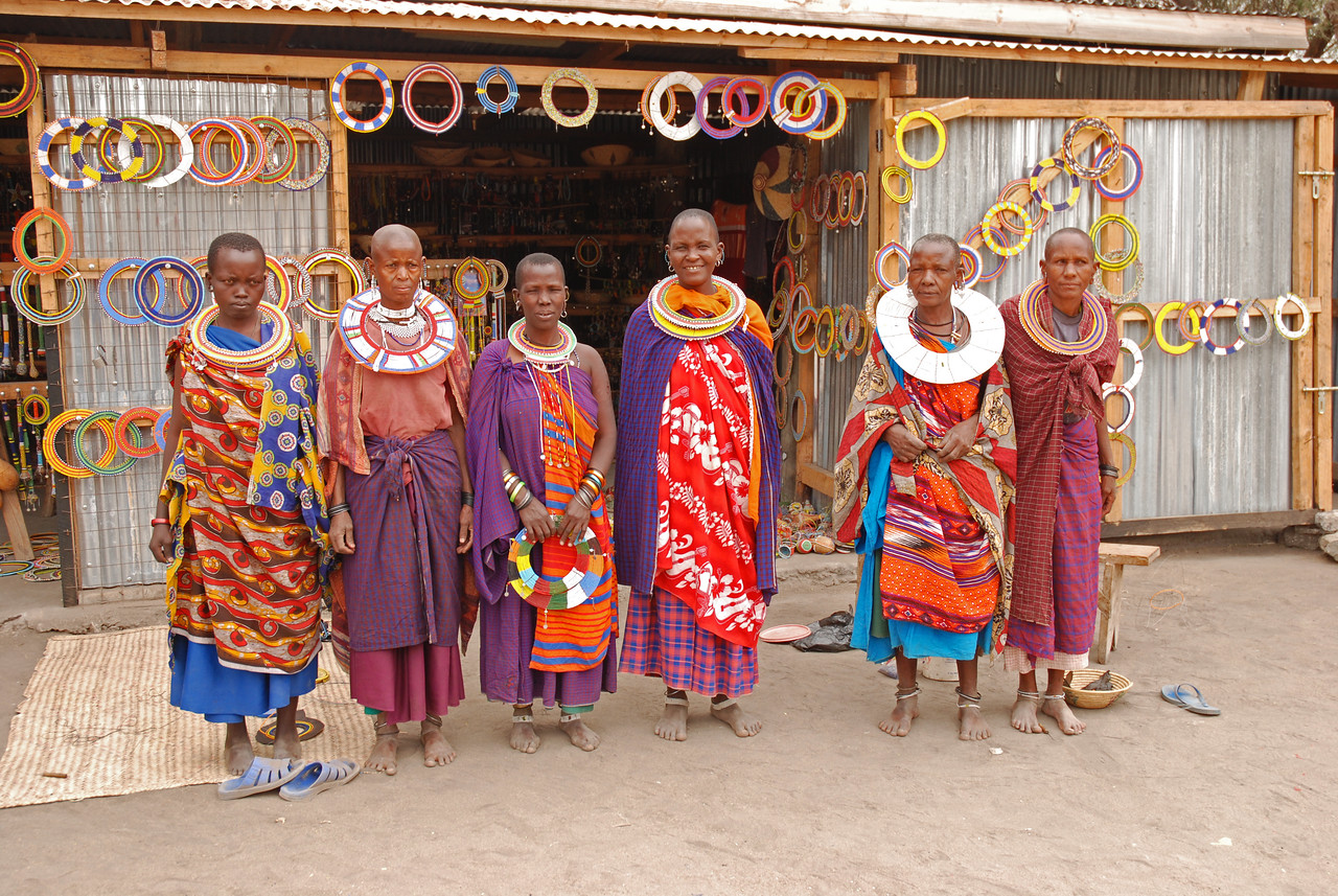 "These friendly women in rural Tanzania were delighted when Robert asked them in Maa for permission to take their picture - ""Aosh empicha?"" →<br /> <br /> The opportunity to interact with the people in the rural villages of Tanzania and Kenya. One advantage of self-driving is that it forces you to be independent and interact with the local people and not to rely on your guide. We were warmly received wherever we went, even in the most remote locations, where we looked as though we had been beamed in from another planet.<br /> <br /> Returning to Serian Camp from the Mara Triangle, we became lost in the village of Mararianda. We turned onto what we thought was the road north only to discover after 50m or so that it was in fact either a game trail or a walking path. We went in circles trying to find our way to the road, much to the amusement of the villagers who appeared in droves to watch. With many gestures and much laughter on both parts, the villagers helped us find our way.<br /> <br /> Driving across the Kenyan/Tanzanian border at Isibania/Sirari - complete and utter chaos but an experience we wouldn't have missed."