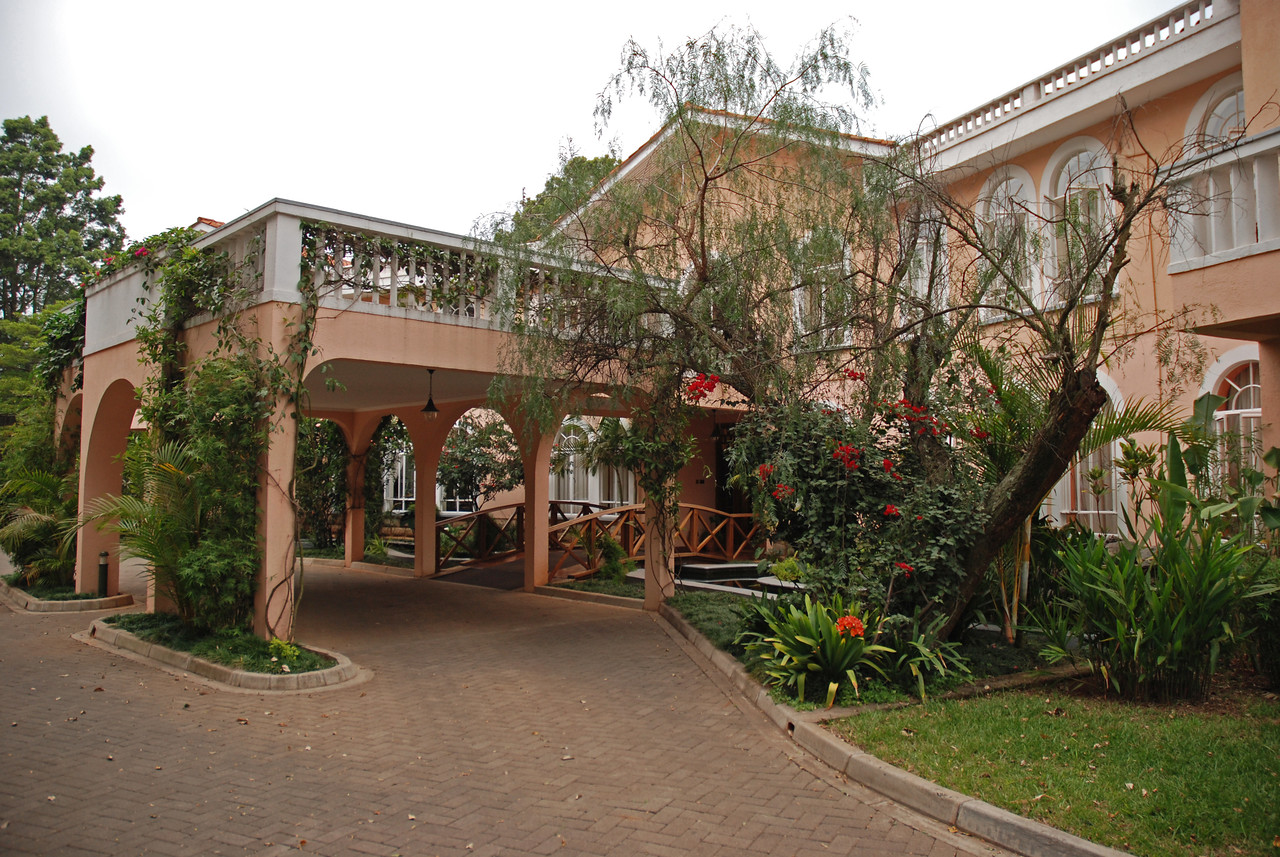 Friday 31st July <br /> Nairobi to Serian Camp in the Mara North Conservancy, Kenya<br /> <br /> ← The House of Waine in Nairobi<br /> <br /> In the morning, we were awake before the alarm so, after showering, we walked around the gardens and admired the House of Waine. It had been too dark when we arrived to appreciate our surroundings, which we discovered were lovely.  <br /> <br /> Breakfast was delicious, with fresh orange and mango juice, scrambled eggs, bacon, sausage, beans, toast, fresh banana muffins, fruit salad and delicious, but very strong coffee. After breakfast, we arranged to have internet in our room and sent an email to family and friends to let them know that we had arrived safely in Kenya.