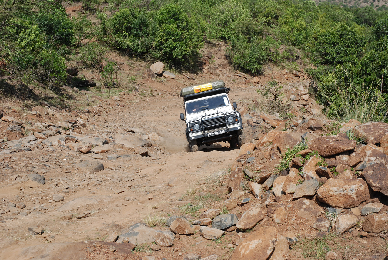 ← The road south of the village of Mararianda in Kenya  <br /> <br /> The 2005 Land Rover Defender 110 Tdi, which took us safely along some of the worst roads in the world - the road between the Serengeti and Ngorongoro Crater comes to mind.<br /> <br /> The last stretch of road north to the village of Mararianta from the Mara in Kenya. Picture a streambed with huge boulders, large rocks, loose gravel and sand. Tip it up 40° and you get the idea. We stood at the bottom and debated whether it could possibly be the road, but our GPS confirmed that it was. How the Land Rover made it to the top is a mystery. The 4x4 only got stuck once, when it got hung up on a large boulder. One of the more memorable drives of the trip!