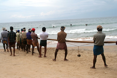 Fisherman hauling in their catch, while singing along