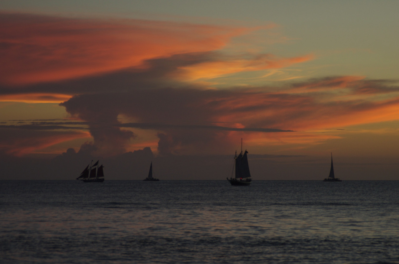This was a great sunset. Hold your cursor over the photo and pick a larger size to see all the details in the boats.