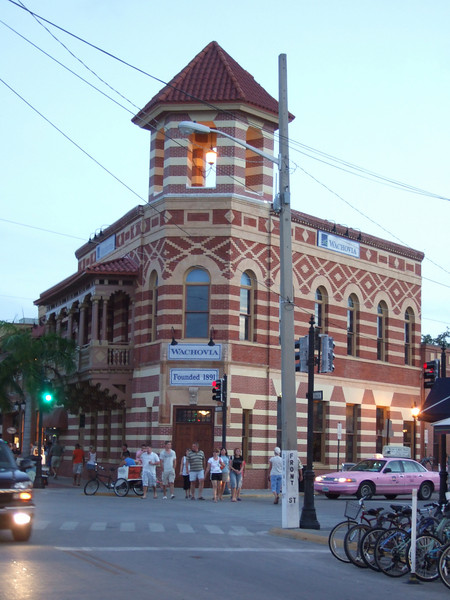 """The building housing what is now a branch of Wachovia was originally the First National Bank, founded in 1891. The people at the First National refused to cash a thousand dollar check for royalties for """"A Farewell to Arms"""" held by some scruffy guy called Hemingway. The local bar did, though, and Sloppy Joe's entered into history."""