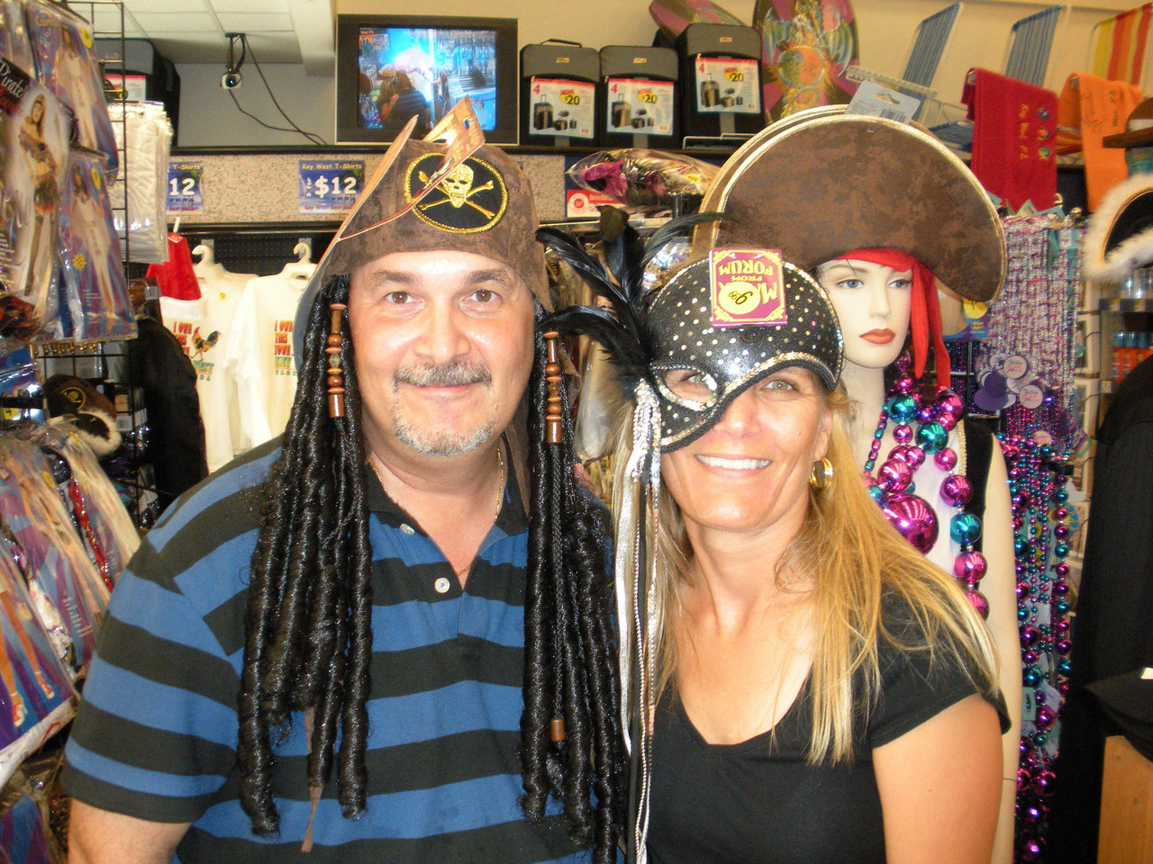 The 2008 theme had to do with pirates, so this lovely couple was trying on costumes at the Walgreen's. There's no mirror, so I showed them their photo on my camera's LCD screen.