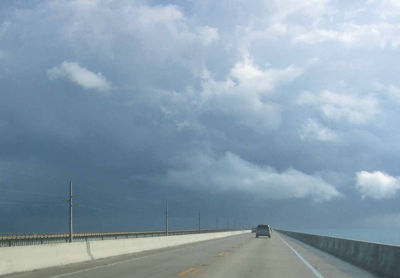 Driving on the causeway into a storm.