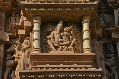 "Some remarkably detailed and fine stone carvings at Khajuraho. Khajuraho - Land Of The Moon God is located in the Indian state of Madhya Pradesh (MP) and roughly 620 kilometers (385 miles) southeast of New Delhi. Khajuraho was the cultural capital of the Chandela Rajputs, a Hindu dynasty that ruled from the 10th to 12th centuries. The temples of Khajuraho are famous for their so-called ""erotic sculptures"".  Symbolising a medieval legacy, the Khajuraho temples are a perfect fusion of architectural and sculptural excellence, representing one of the finest examples of Indian art. To some, they are the most graphic, erotic and sensuous sculptures the world has ever known. But Khajuraho has not received the attention it deserves for its significant contribution to the religious art of India - there are literally hundreds of exquisite images on the interior and exterior walls of the shrines.  Architecturally they are unique. While each temple has a distinct plan and design, several features are common to all. They are all built on high platforms, several metres off the ground. The stone used throughout is either granite or a combination of light sandstone and granite. Each of these temples has an entrance hall or mandapa, and a sanctum sanctorum or garbha griha. The roofs of these various sections have a distinct form. The porch and hall have pyramidal roofs made of several horizontal layers. The inner sanctum's roof is a conical tower - a colossal pile of stone (often 30m high) made of an arrangement of miniature towers called shikharas."