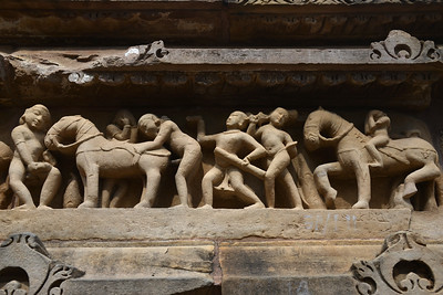 "Erotic and sexual acts depicted in stone carvings at Khajuraho. Khajuraho - Land Of The Moon God is located in the Indian state of Madhya Pradesh (MP) and roughly 620 kilometers (385 miles) southeast of New Delhi. Khajuraho was the cultural capital of the Chandela Rajputs, a Hindu dynasty that ruled from the 10th to 12th centuries. The temples of Khajuraho are famous for their so-called ""erotic sculptures"".  Symbolising a medieval legacy, the Khajuraho temples are a perfect fusion of architectural and sculptural excellence, representing one of the finest examples of Indian art. To some, they are the most graphic, erotic and sensuous sculptures the world has ever known. But Khajuraho has not received the attention it deserves for its significant contribution to the religious art of India - there are literally hundreds of exquisite images on the interior and exterior walls of the shrines.  Architecturally they are unique. While each temple has a distinct plan and design, several features are common to all. They are all built on high platforms, several metres off the ground. The stone used throughout is either granite or a combination of light sandstone and granite. Each of these temples has an entrance hall or mandapa, and a sanctum sanctorum or garbha griha. The roofs of these various sections have a distinct form. The porch and hall have pyramidal roofs made of several horizontal layers. The inner sanctum's roof is a conical tower - a colossal pile of stone (often 30m high) made of an arrangement of miniature towers called shikharas."
