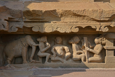 """Detailed and fine stone carvings at Khajuraho. Khajuraho - Land Of The Moon God is located in the Indian state of Madhya Pradesh (MP) and roughly 620 kilometers (385 miles) southeast of New Delhi. Khajuraho was the cultural capital of the Chandela Rajputs, a Hindu dynasty that ruled from the 10th to 12th centuries. The temples of Khajuraho are famous for their so-called """"erotic sculptures"""".  Symbolising a medieval legacy, the Khajuraho temples are a perfect fusion of architectural and sculptural excellence, representing one of the finest examples of Indian art. To some, they are the most graphic, erotic and sensuous sculptures the world has ever known. But Khajuraho has not received the attention it deserves for its significant contribution to the religious art of India - there are literally hundreds of exquisite images on the interior and exterior walls of the shrines.  Architecturally they are unique. While each temple has a distinct plan and design, several features are common to all. They are all built on high platforms, several metres off the ground. The stone used throughout is either granite or a combination of light sandstone and granite. Each of these temples has an entrance hall or mandapa, and a sanctum sanctorum or garbha griha. The roofs of these various sections have a distinct form. The porch and hall have pyramidal roofs made of several horizontal layers. The inner sanctum's roof is a conical tower - a colossal pile of stone (often 30m high) made of an arrangement of miniature towers called shikharas."""