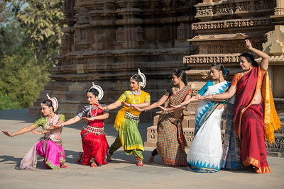 The wave by Odissi dance Guru Smt Daksha Mashruwala and her students of Kaishiki, Namrata Mehta, Subrata Tripathy, Dhruvi Saachi Jaiin, Anuradha Sanghvi and Tamanna Tanna. Khajuraho Dance Festival, Feb 2017. Colorful and brilliant classical dance forms of India with roots in the rich cultural traditions offer a feast for the eyes during a weeklong extravaganza. Khajuraho Temples in Madhya Pradesh are popular for their architectural wonders and sculptures.