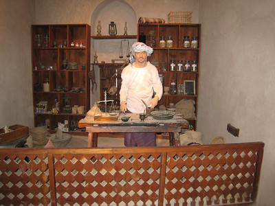 Model of an old style chemist at work.