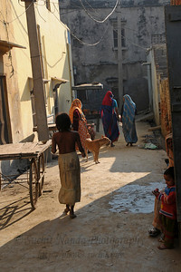 "Streets of Khurja, UP.  खुर्जा Khurja is a city in Bulandshahr district of Uttar Pradesh in north India. It is situated around 85 km from Delhi and is famous for its pottery. Khurja supplies a large portion of the ceramics and pottery used in the country and also exports the same. Hence Khurja is sometime called ""Khurja: The Ceramics City""  The history of Khurja Pottery goes back to about 600 years ago, when some of the potter's families moved to Khurja during reign of Emperor Mohammad-bin-Tughlak from Delhi and started with red clay Pottery. They moved on to blue glaze which became very popular. Clay articles with engobe of white clay, painting floral designs with cupric oxide and applying a soft glaze (containing glass and borax etc.) were the hall mark of this small city in UP."