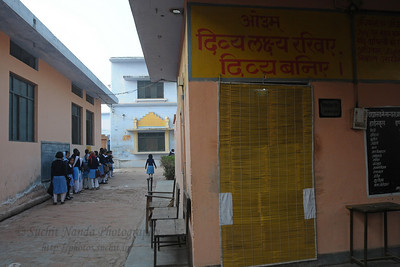 "Arya Kanya Pathsala (Girl's School) in Khuraj, UP.  खुर्जा  Khurja is a city in Bulandshahr district of Uttar Pradesh in north India. It is situated around 85 km from Delhi and is famous for its pottery. Khurja supplies a large portion of the ceramics and pottery used in the country and also exports the same. Hence Khurja is sometime called ""Khurja: The Ceramics City""  The history of Khurja Pottery goes back to about 600 years ago, when some of the potter's families moved to Khurja during reign of Emperor Mohammad-bin-Tughlak from Delhi and started with red clay Pottery. They moved on to blue glaze which became very popular. Clay articles with engobe of white clay, painting floral designs with cupric oxide and applying a soft glaze (containing glass and borax etc.) were the hall mark of this small city in UP."