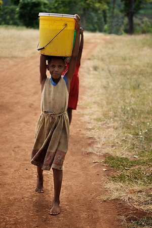 Little girls carrying water. Marangu village, Moshi district, Tanzania.