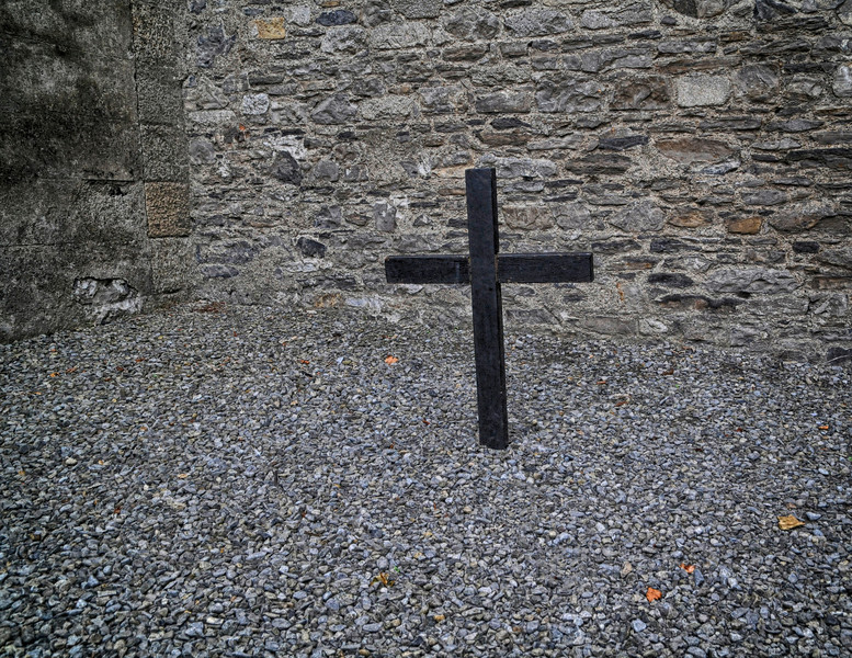Cross in the Prison Yard marking the spot where James Connolly was executed by firing squad in 1916 for his part in the Easter Rising. Connolly had been injured during the fighting, and was tied to a chair for execution, since he was unable to stand.