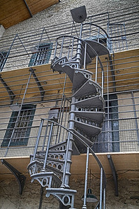 Cast iron spiral stairs and cells in the Victorian part of the prison.