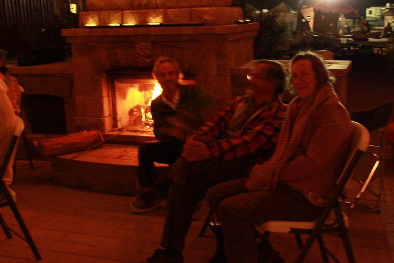 Howard, Frank and Theresa ended back at the fireplace where another group was playing their bluegrass.