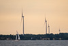 Sailboat on Lake Ontario in front of wind turbines on Amherst Island.