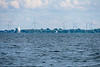 Sailboat on Lake Ontario. Wolfe Island turbines behind.