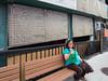 Denise Metatawabin sitting on Brock Street.