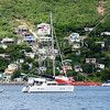 Catamaran boat anchored off the shore of Bequia island in St Vincent.
