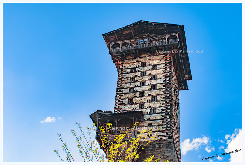 Another view of Chehni Kothi. Chehni Kothi, a tower temple cum fort, is believed to be 1500 years old and is built entirely of stone and wood in the traditional Himachali Kath-Kuni architectural style. It was originally 15 storeys tall. An earthquake in 1905, however, destroyed its top five floors. Chehni Kothi is considered the tallest heritage structure in Himachal Pradesh. According to locals, the twin towers are residences of Gods and are stocked with ancient treasure. Consequently, they don't permit entry of outsiders inside either of the two towers.