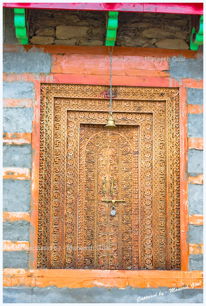 Intricately carved door of the local temple. Pedcha village.