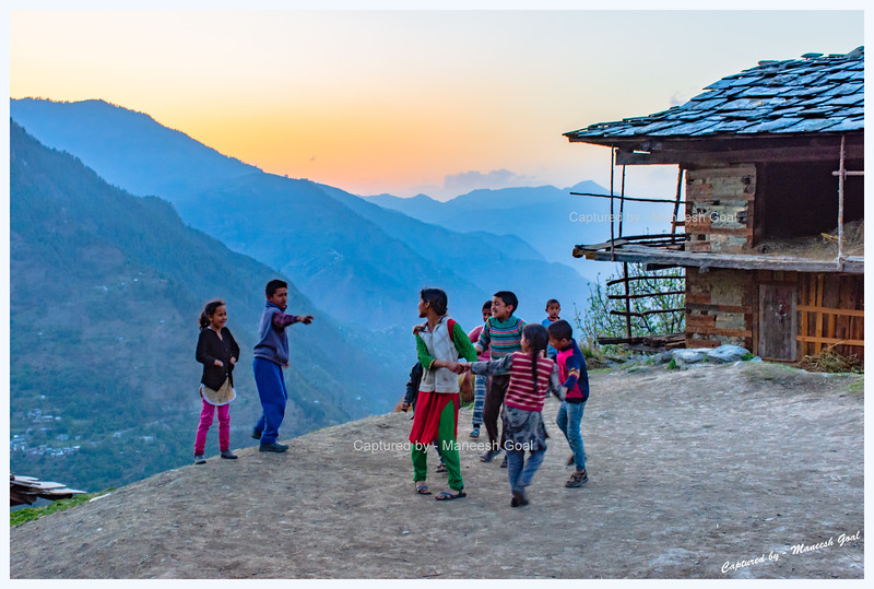 Kids playing in Bihar village. Tirthan Valley - Banjar region in the background.